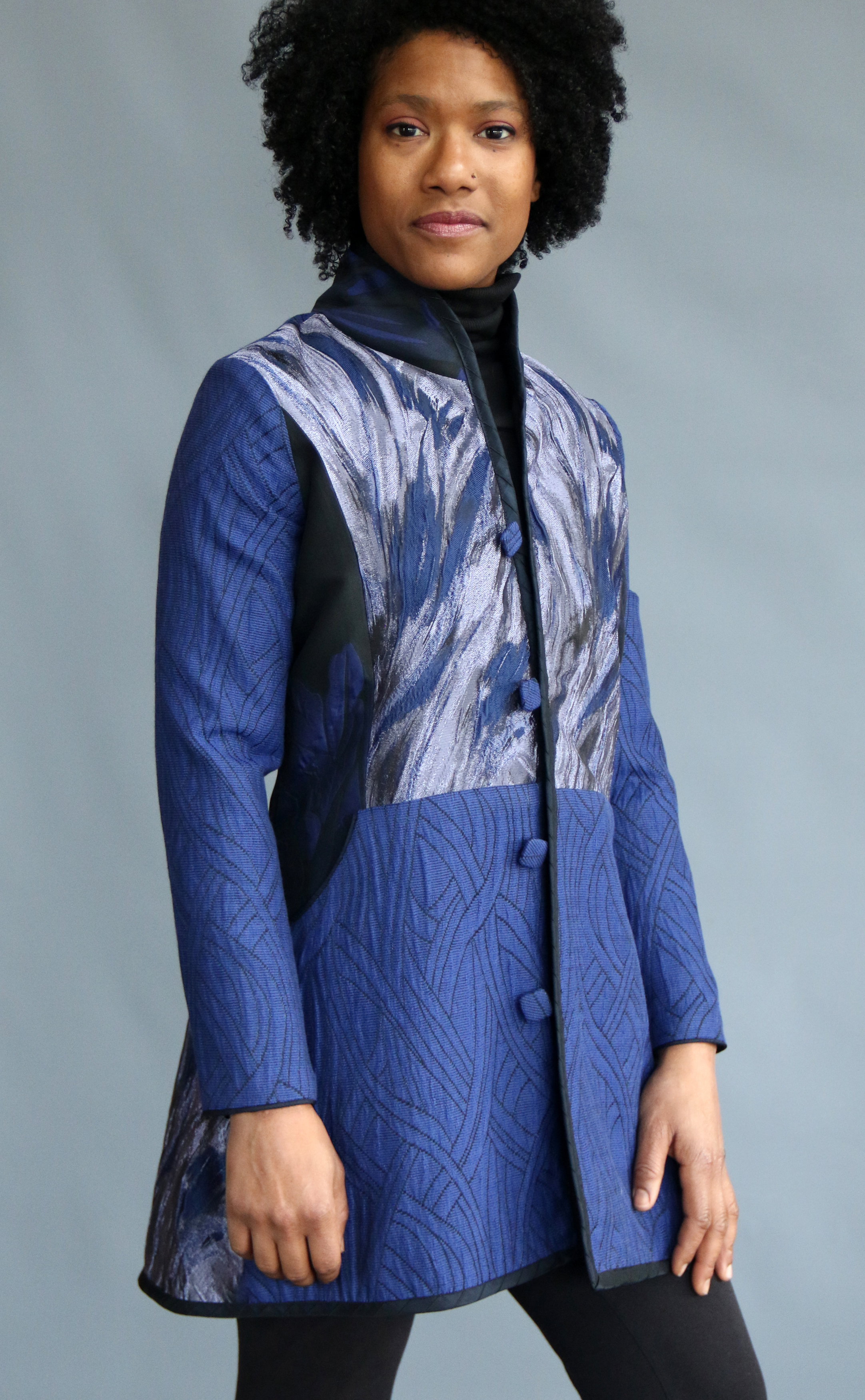 tailored coat sewn from blue patterned silk and cotton fabrics