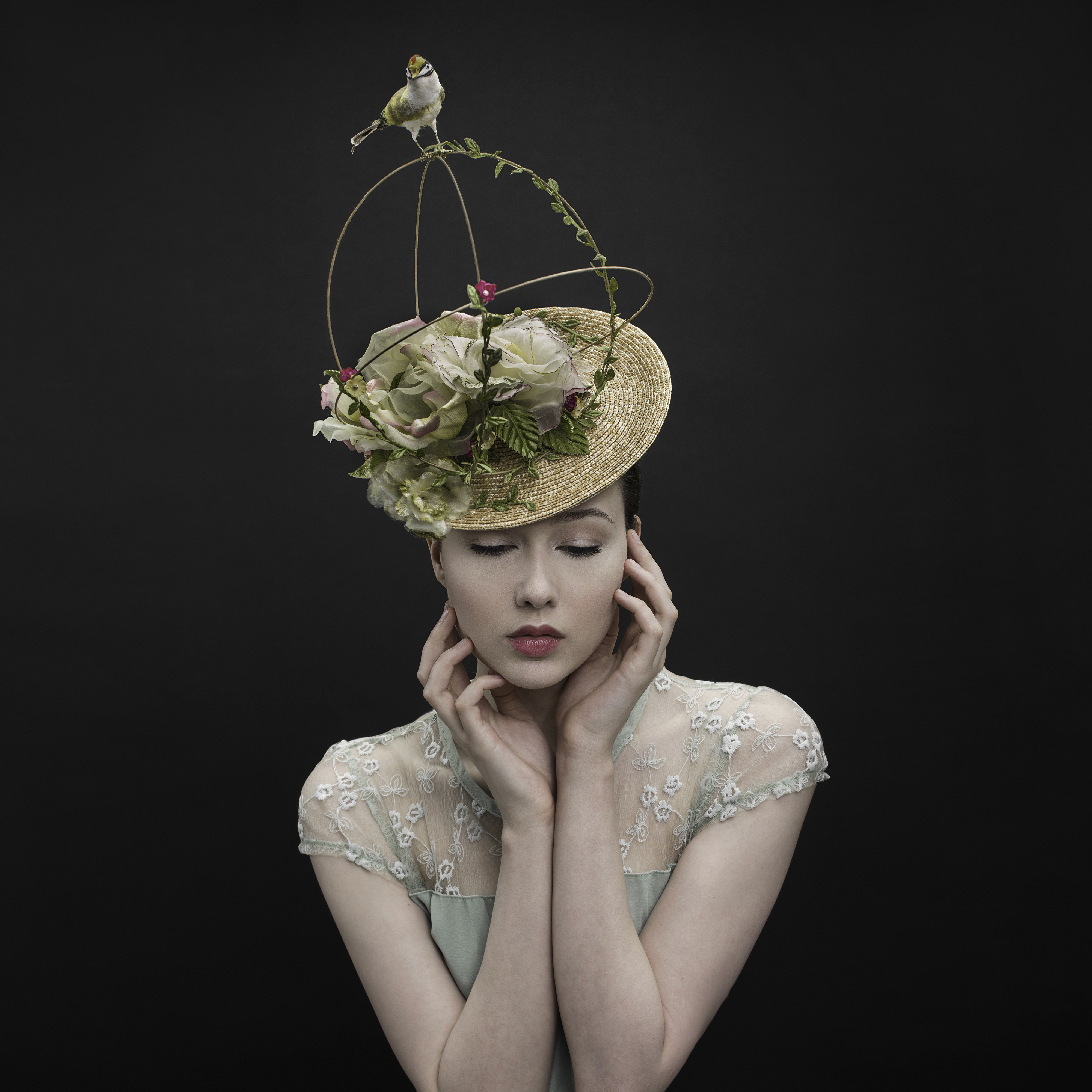braided wheat straw hat trimmed with wire and silk flowers