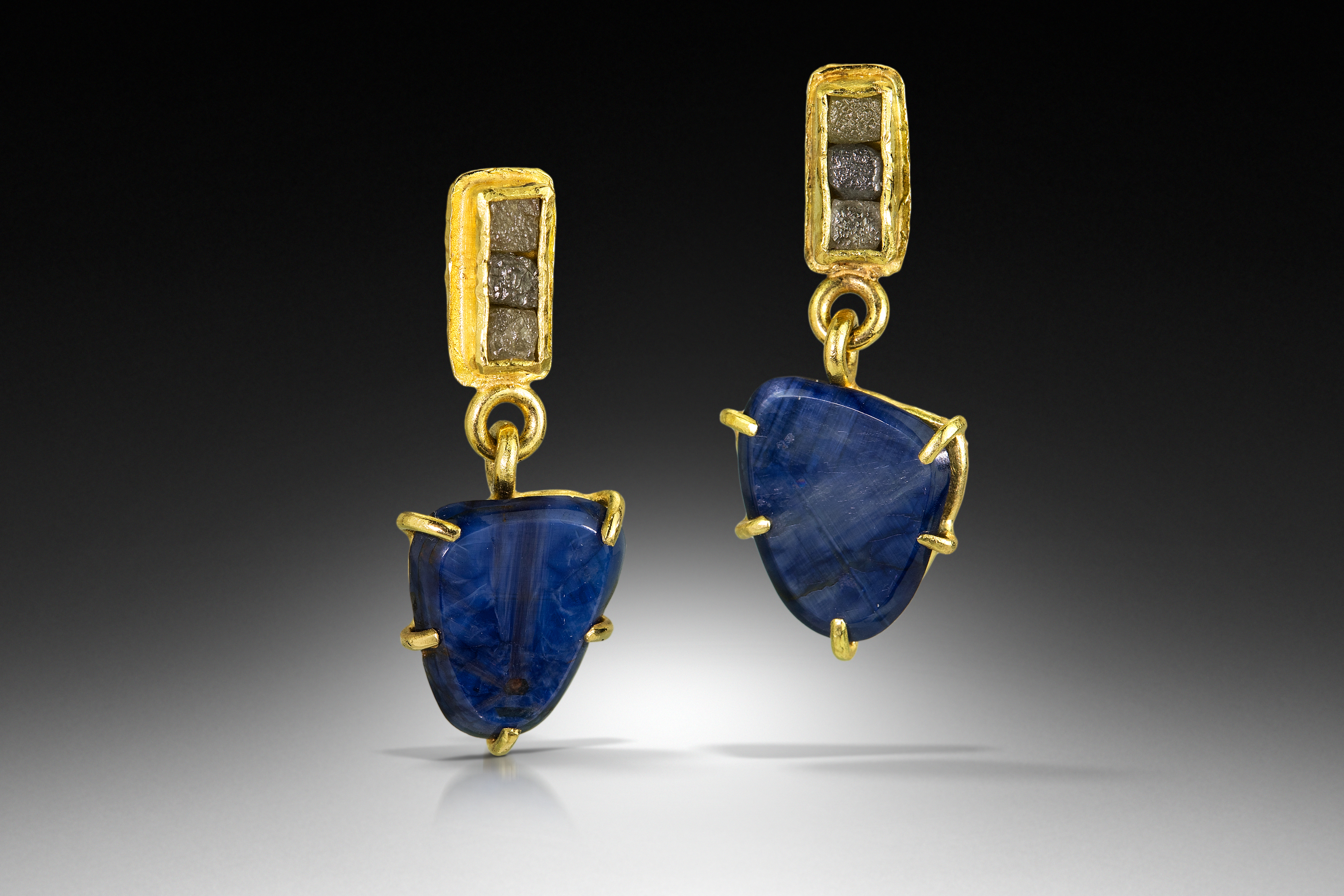 shield sapphire slice earrings hung from natural diamond cubes