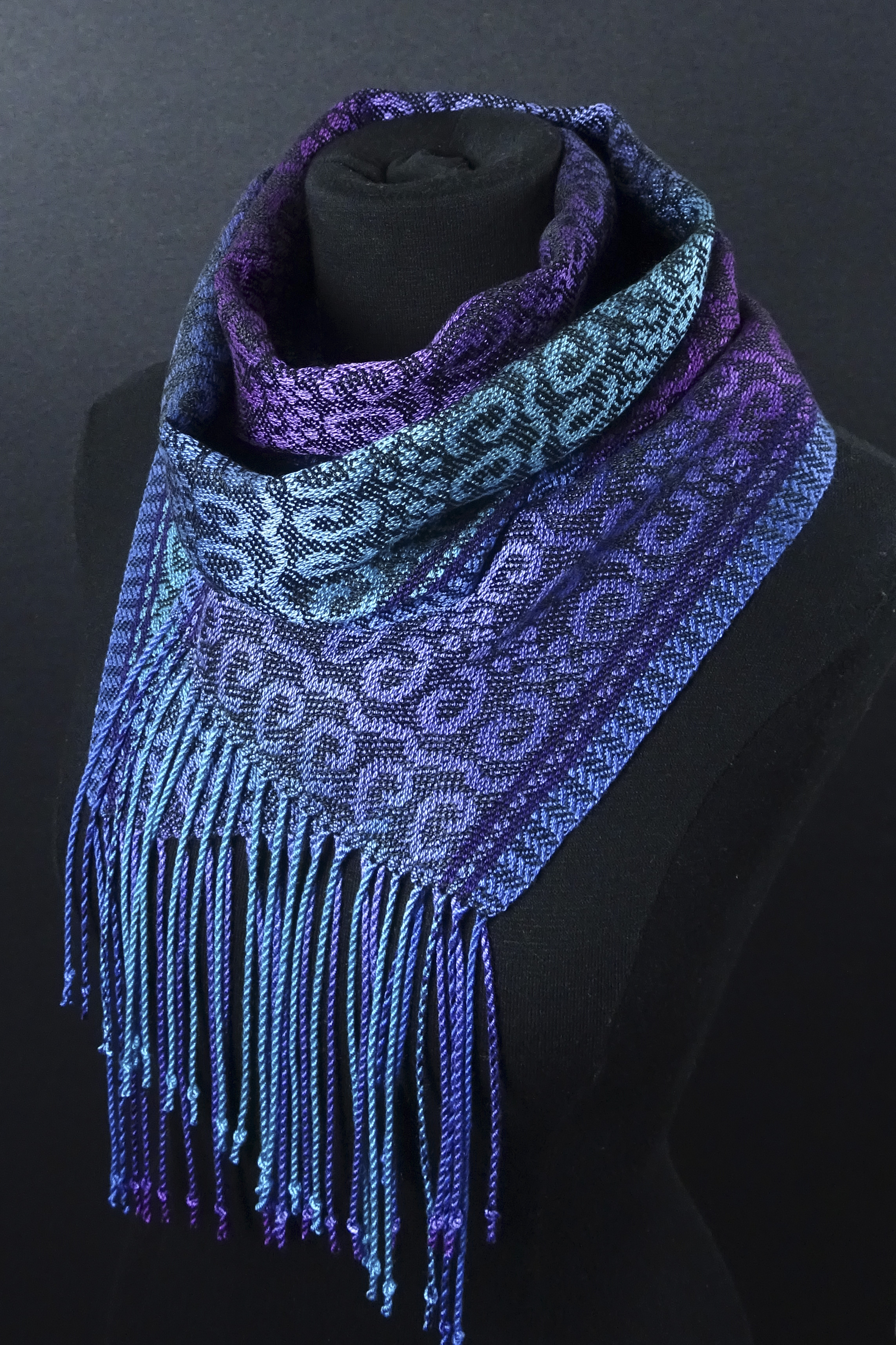 purple and blue handwoven scarf