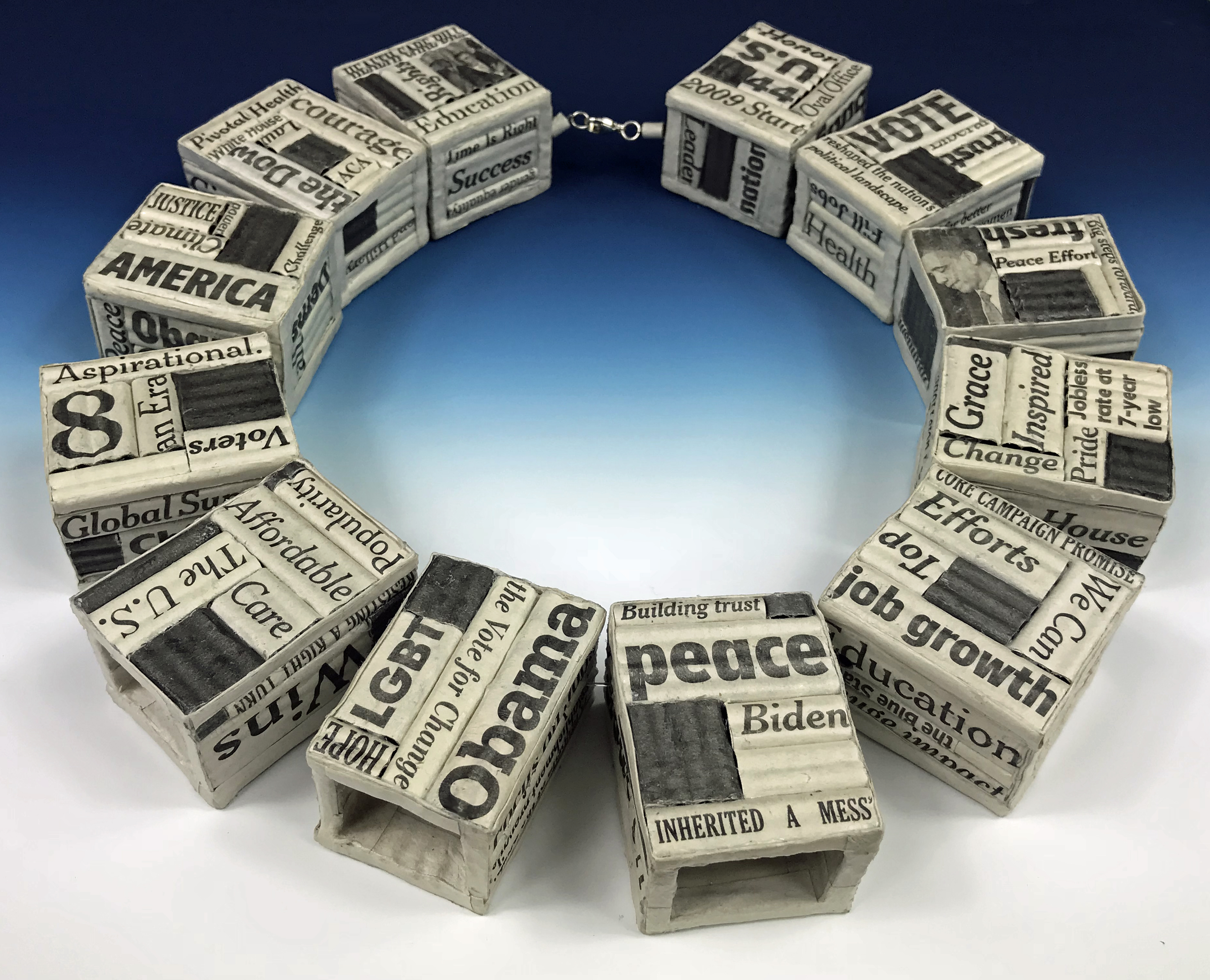 necklace consisting of recycled USA Today, New York Times, Wall Street Journal