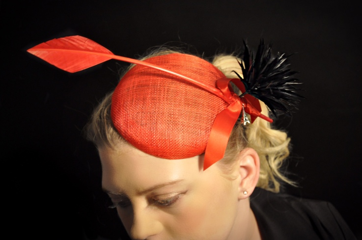 red fascinator with feathers
