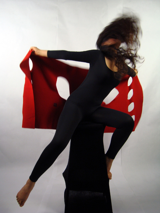 Leaping woman with red felt vest