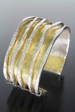 Silver and gold cuff with ridges