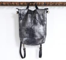 Convertible black backpack/shoulder bag. Large hand sewn outside pocket
