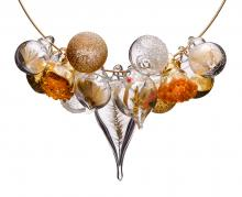 plants enclosed in blown glass forming a pendant