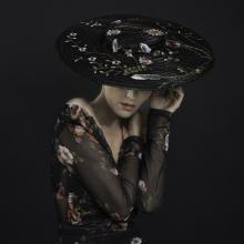 matchstick straw hat, embellished with embroidered net