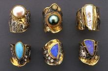 rings with fused layers of patterned sterling silver and gold with various stones