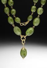 peridot linked gold necklace