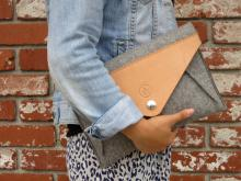 This simple clutch features a waxed canvas interior pocket and a leather exterior pocket.