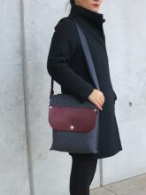A German Wool felt and leather messenger bag with a comfortable nylon adjustable strap