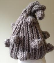 Grey knit beanie with bubbles.