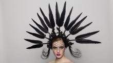 A black statement piece constructed with duck feathers, peacock feathers, lace, veil and millinery wire