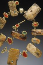 rectangular chunks of amber set in oxidized sterling silver and 18K