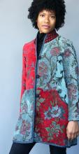 tailored coat sewn from red and blue woven fabrics