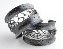 Two metal cuff bracelets
