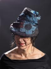 blue and black felt hat with veil
