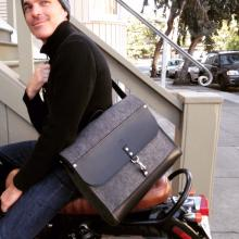 Part briefcase, part all-purpose bag. Inside, it features a laptop sleeve and waxed canvas pockets. Removable strap.