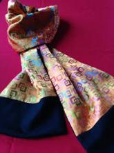 This one of a kind scarf is made from combining various patterns of woven silk together