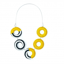 paper necklace in black, white, and golden yellow