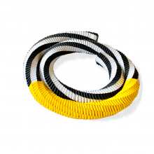 paper bracelet in black, white, and golden yellow